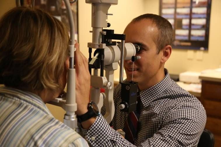Examining a patient at Precision Eye Care